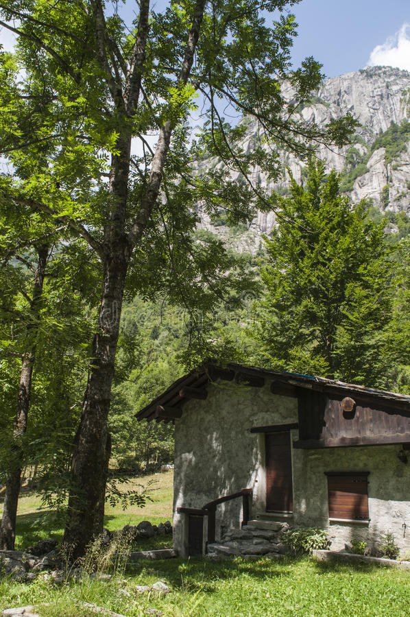 Val di Mello, Val Masino, Valtellina, Sondrio, Italy, Europe. Italy, 03/08/2017: mountain retreat in the Mello Valley, Val di Mello, a green valley surrounded by stock image
