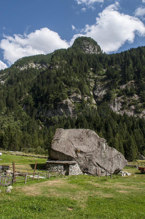 Val di Mello, Val Masino, Valtellina, Sondrio, Italy, Europe. Italy, 03/08/2017: an outdoor pantry made in the rock in the Val di Mello, green valley surrounded royalty free stock photo