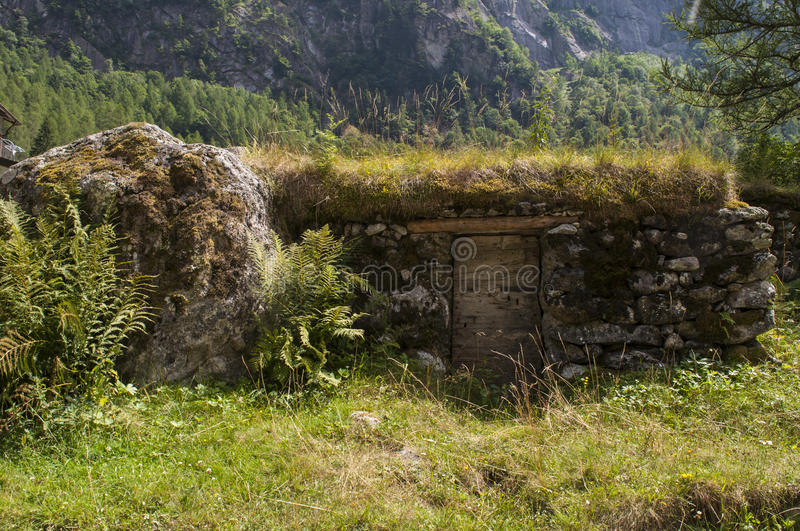 Val di Mello, Val Masino, Valtellina, Sondrio, Italy, Europe. Italy, 03/08/2017: an outdoor pantry made in the rock in the Val di Mello, green valley surrounded stock photo