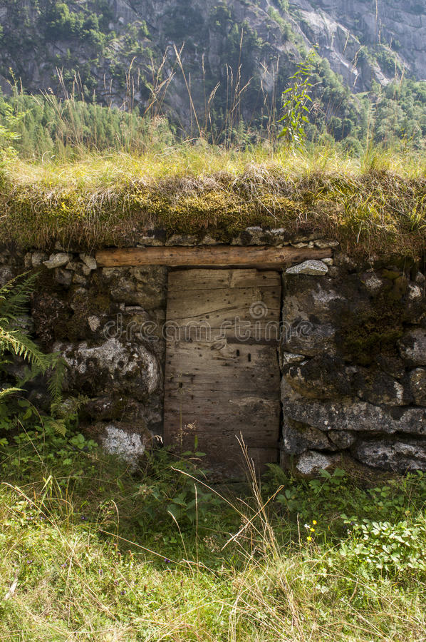 Val di Mello, Val Masino, Valtellina, Sondrio, Italy, Europe. Italy, 03/08/2017: an outdoor pantry made in the rock in the Val di Mello, green valley surrounded stock image