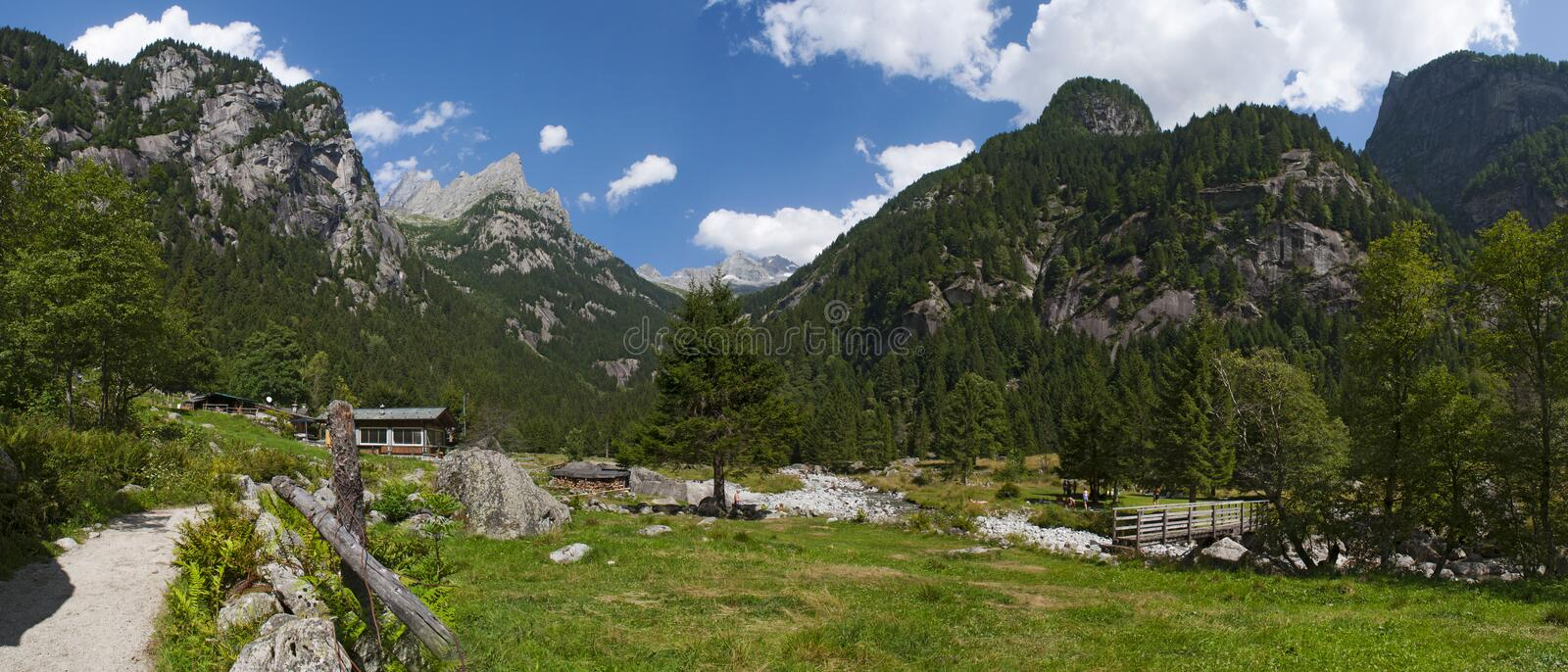 Val di Mello, Val Masino, Valtellina, Sondrio, Italy, Europe. Italy, 03/08/2017: panoramic view of the Mello Valley, Val di Mello, a green valley surrounded by royalty free stock photos