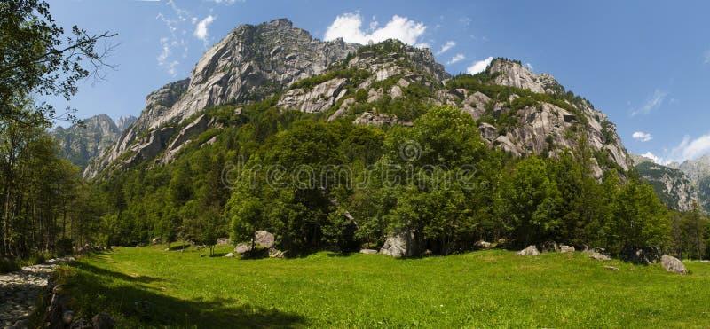 Val di Mello, Val Masino, Valtellina, Sondrio, Italy, Europe. Italy, 03/08/2017: panoramic view of the Mello Valley, Val di Mello, a green valley surrounded by royalty free stock photos