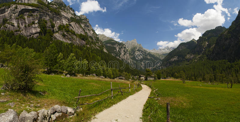 Val di Mello, Val Masino, Valtellina, Sondrio, Italy, Europe. Italy, 03/08/2017: panoramic view of the Mello Valley, Val di Mello, a green valley surrounded by stock photography