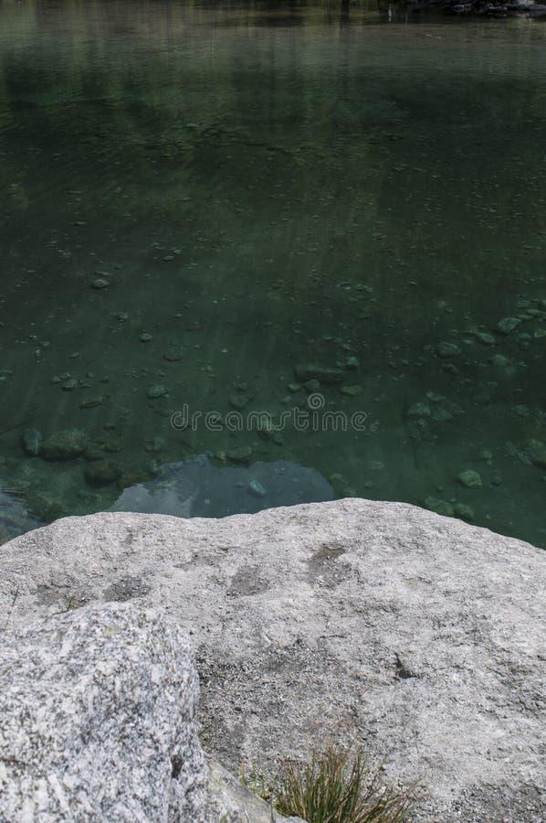Val di Mello, Val Masino, Valtellina, Sondrio, Italy, Europe. Italy, 03/08/2017: a rock on the alpine lake in the Val di Mello, a green valley surrounded by stock photos