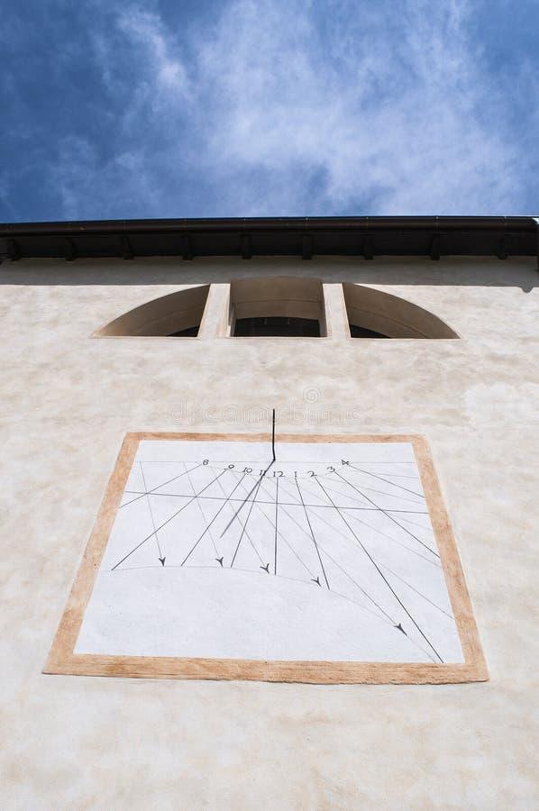 Val di Mello, Val Masino, Valtellina, Sondrio, Italy, Europe. Italy, 03/08/2017: the sundial on the parish church of San Martino, Saint Martin, the village stock photos