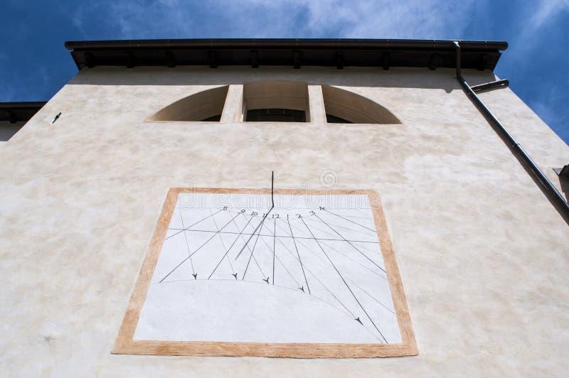 Val di Mello, Val Masino, Valtellina, Sondrio, Italy, Europe. Italy, 03/08/2017: the sundial on the parish church of San Martino, Saint Martin, the village royalty free stock images