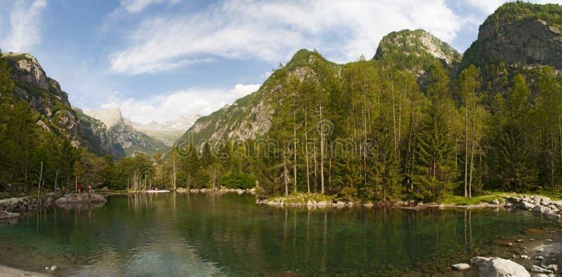 Val di Mello, Val Masino, Valtellina, Sondrio, Italy, Europe. Italy, 03/08/2017: view of the alpine lake in the Mello Valley, Val di Mello, a green valley stock photography