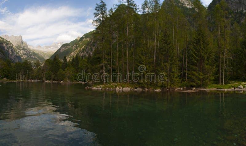 Val di Mello, Val Masino, Valtellina, Sondrio, Italy, Europe. Italy, 03/08/2017: view of the alpine lake in the Mello Valley, Val di Mello, a green valley stock images