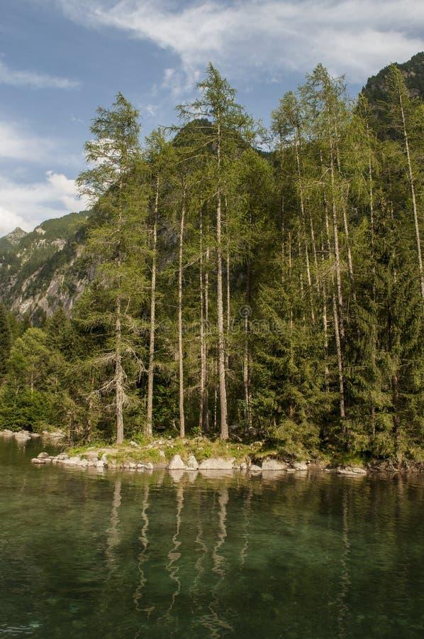 Val di Mello, Val Masino, Valtellina, Sondrio, Italy, Europe. Italy, 03/08/2017: view of the alpine lake in the Mello Valley, Val di Mello, a green valley royalty free stock photo