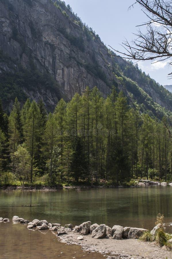 Val di Mello, Val Masino, Valtellina, Sondrio, Italy, Europe. Italy, 03/08/2017: view of the alpine lake in the Mello Valley, Val di Mello, a green valley royalty free stock images