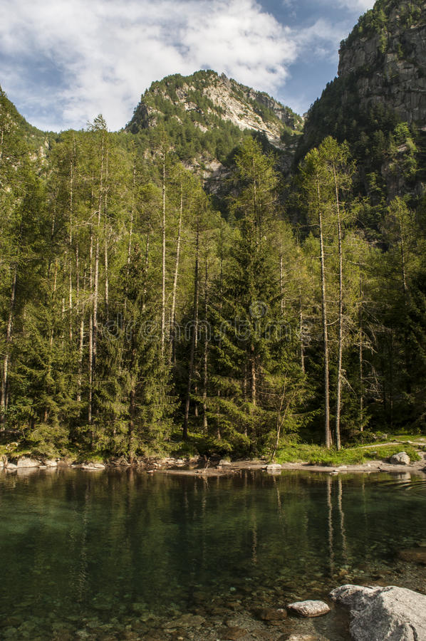Val di Mello, Val Masino, Valtellina, Sondrio, Italy, Europe. Italy, 03/08/2017: view of the alpine lake in the Mello Valley, Val di Mello, a green valley stock images