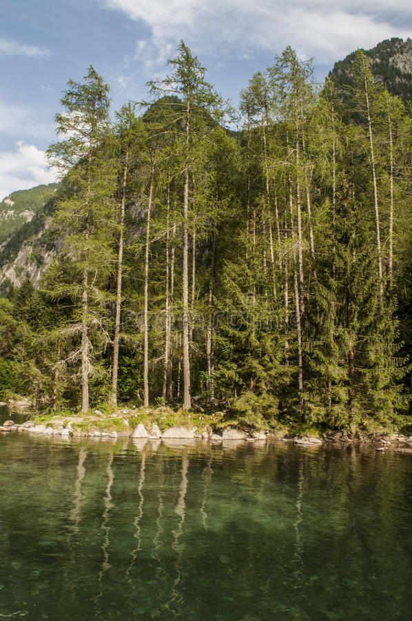 Val di Mello, Val Masino, Valtellina, Sondrio, Italy, Europe. Italy, 03/08/2017: view of the alpine lake in the Mello Valley, Val di Mello, a green valley royalty free stock photography