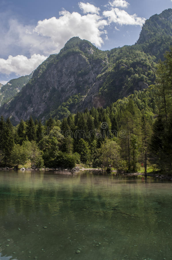 Val di Mello, Val Masino, Valtellina, Sondrio, Italy, Europe. Italy, 03/08/2017: view of the alpine lake in the Mello Valley, Val di Mello, a green valley royalty free stock photos