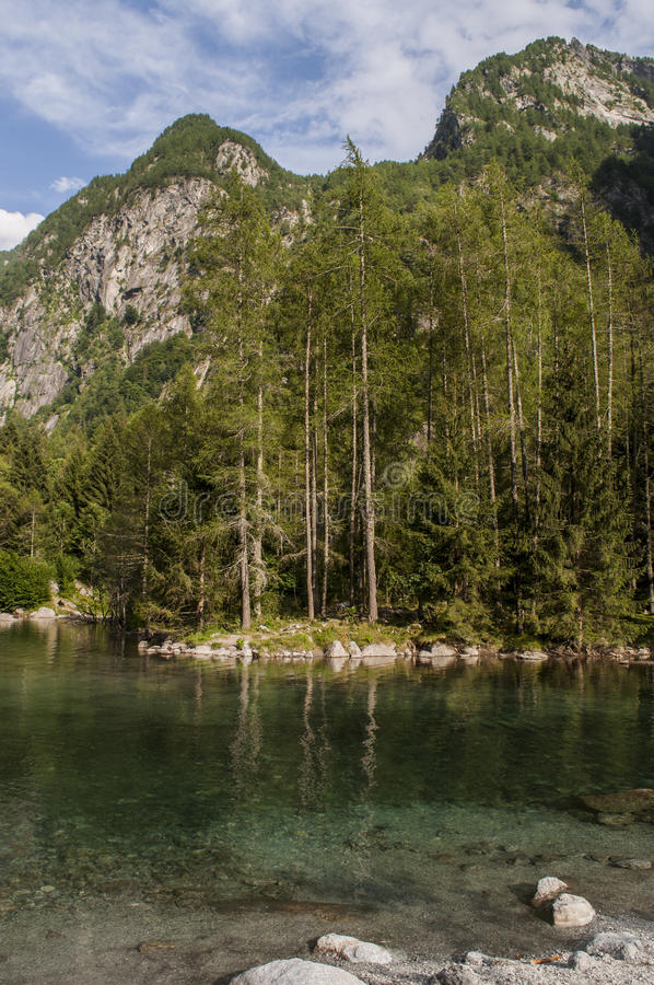 Val di Mello, Val Masino, Valtellina, Sondrio, Italy, Europe. Italy, 03/08/2017: view of the alpine lake in the Mello Valley, Val di Mello, a green valley royalty free stock images