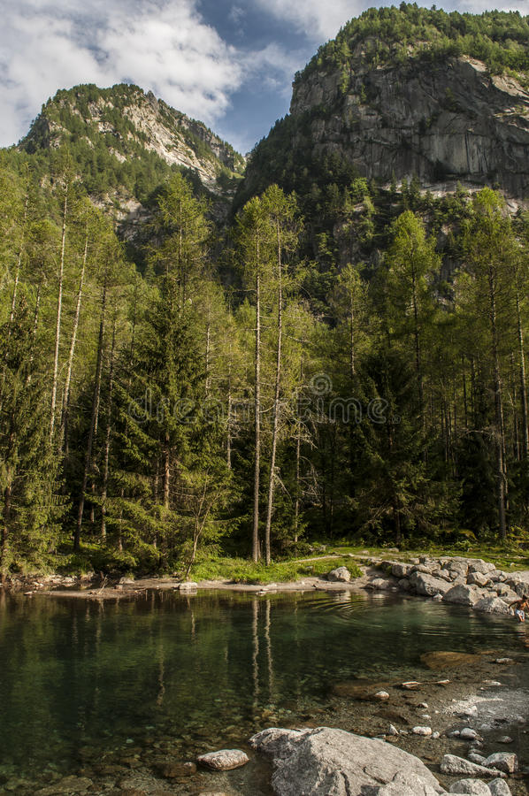 Val di Mello, Val Masino, Valtellina, Sondrio, Italy, Europe. Italy, 03/08/2017: view of the alpine lake in the Mello Valley, Val di Mello, a green valley royalty free stock image