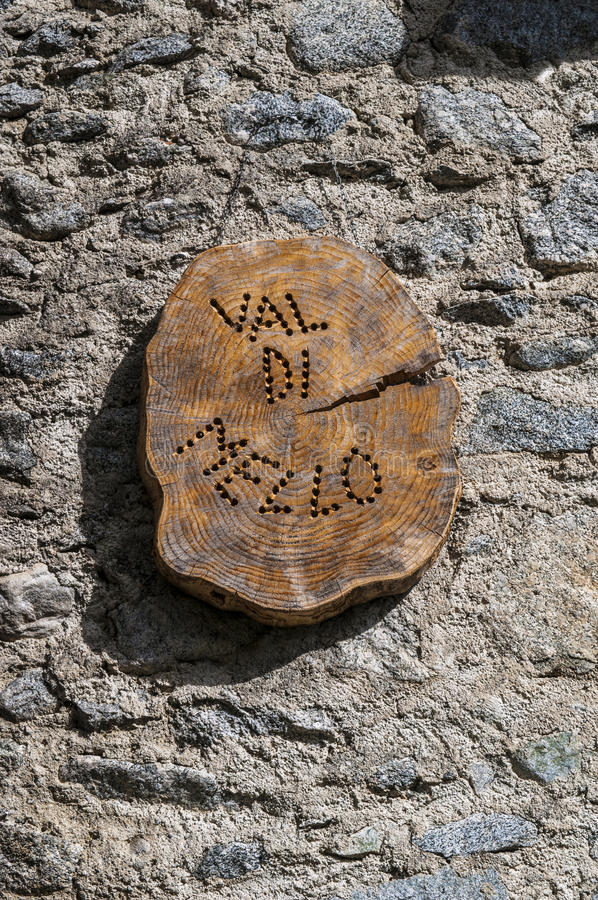 Val di Mello, Val Masino, Valtellina, Sondrio, Italy, Europe. Italy, 03/08/2017: wooden sign of the Mello Valley, Val di Mello royalty free stock photo