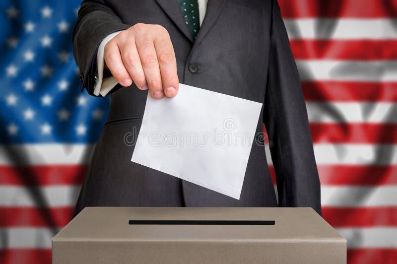 Val i USA - röstning på valurnan fotografering för bildbyråer