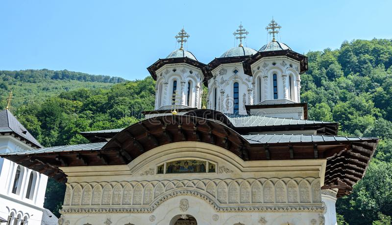 The old Lainici Monastery on a summer`s day, detail of the exterior coupola stock photo