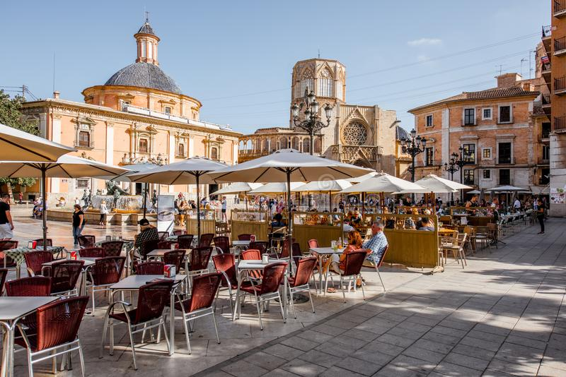 Valencia city in Spain. VALENCIA, SPAIN - August 18, 2017: View on the Virgen square with cafe terrace and cathedral on the background in Valencia city, Spain royalty free stock photo