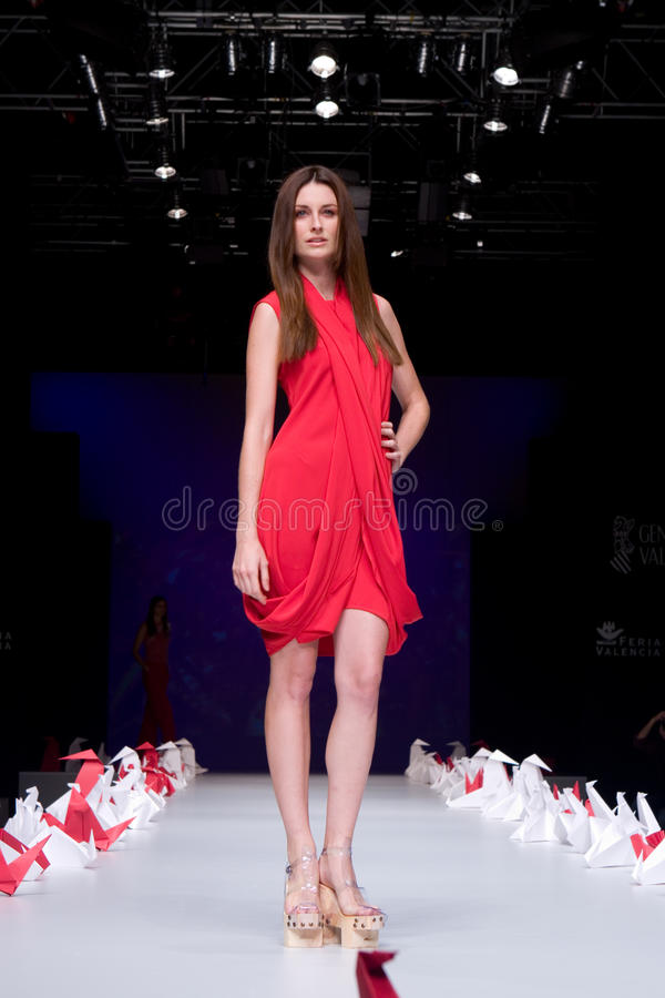 Valencia Fashion Week. VALENCIA, SPAIN - SEPTEMBER 2: A model on the catwalk wears a Higinio Mateu design for the Valencia Fashion Week on September 2, 2010 in stock images
