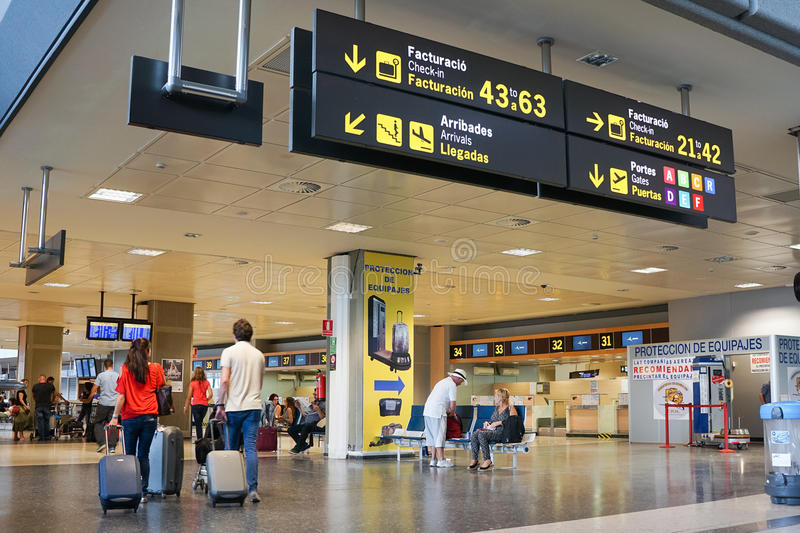 Valencia, Spain Airport. VALENCIA, SPAIN - SEPTEMBER 12, 2015: Airline passengers inside the Valencia Airport. About 4.59 million passengers passed through the royalty free stock images