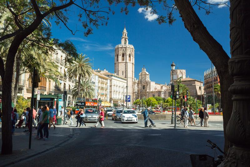 Valencia, Spain - April 16, 2016: Plaza de la Reina square and Micalet tower in Valencia royalty free stock photos