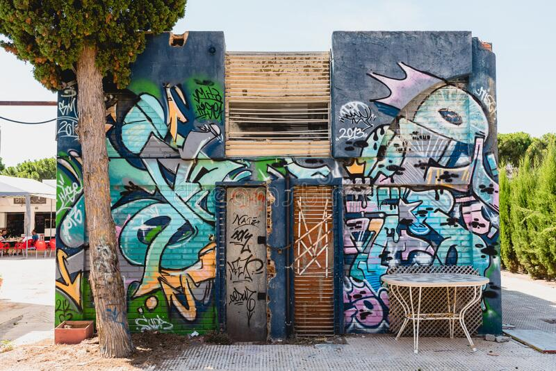 Valencia, Spain - August 8, 2018: Abandoned house full of graffiti.  stock photography