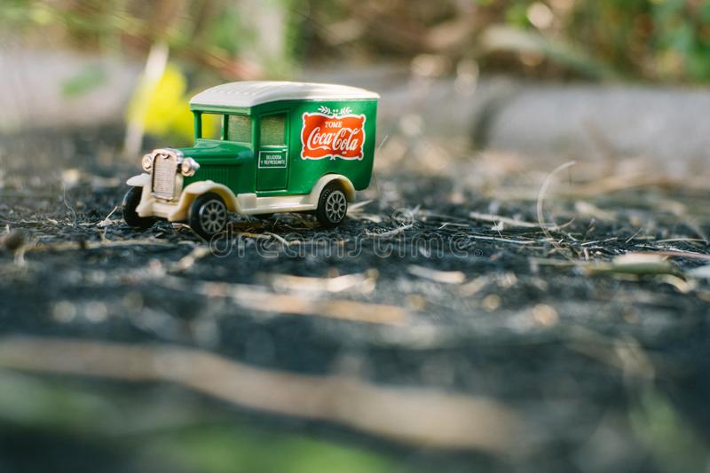 Valencia - Spain, February 13, 2019: old toy truck with coca cola logo on unfocused background royalty free stock images