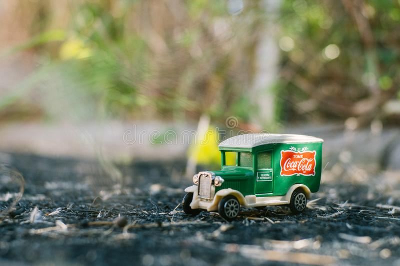 Valencia - Spain, February 13, 2019: old toy truck with coca cola logo on unfocused background stock photography