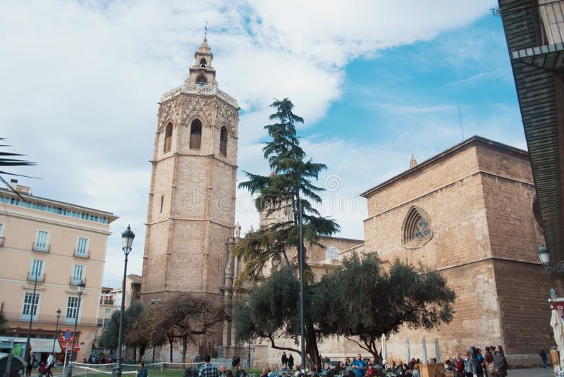 VALENCIA, SPAIN - FEBRUARY 3, 2016: A square in front of Miguelete tower and Metropolitan Cathedral - Basilica of the Assumption royalty free stock photography
