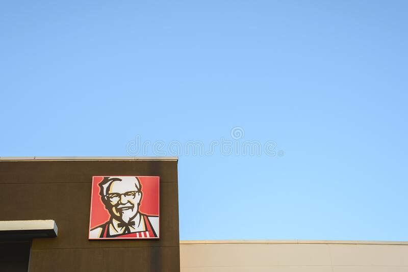 Valencia, Spain - January 3, 2019: KFC logo on top of a restaurant in the Kentucky Fried Chicken fast food royalty free stock photo