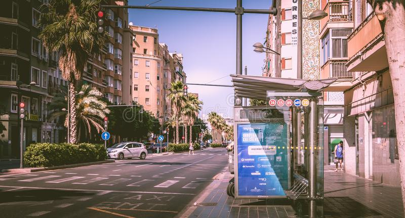 Bus stop of EMT company in a street. VALENCIA, SPAIN - June 18, 2017 : bus stop on a street, manufactured by JCDecaux and used by EMT company, Municipal stock image