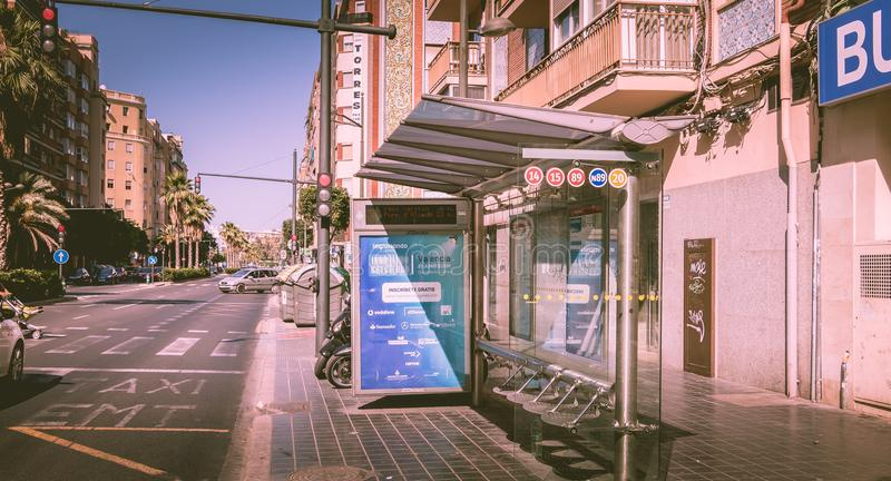 Bus stop of EMT company in a street. VALENCIA, SPAIN - June 18, 2017 : bus stop on a street, manufactured by JCDecaux and used by EMT company, Municipal stock images