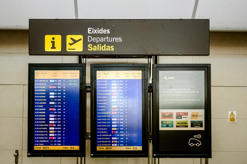 Valencia, Spain - March 8, 2019: Led information panel with flight schedules arrivals departures at a Spanish airport during the stock photography