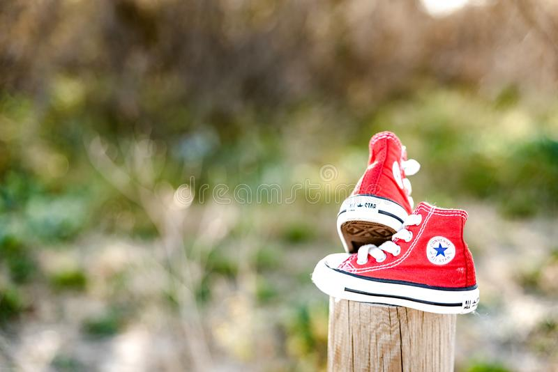 Valencia, Spain - March 3, 2019: Two red baby shoes from the Converse brand.  stock images