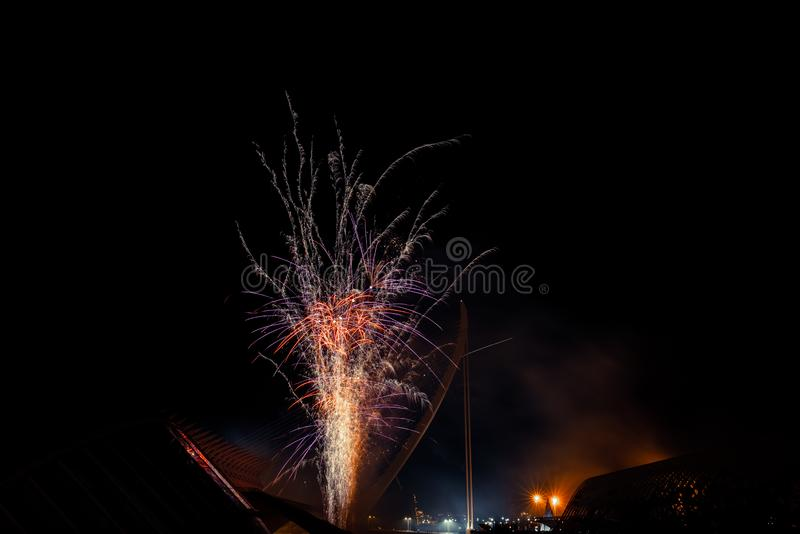 Valencia, Spain - March 1, 2019: Vertical fireworks over black sky with lots of space for text stock images