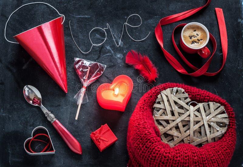 Valentijnskaartendag - liefde of wens rode symbolenmengeling op zwarte royalty-vrije stock afbeelding