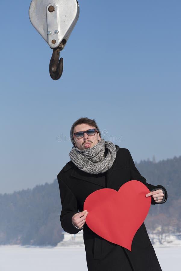 Valentijnskaartenhart Crane Hook Love Attract stock afbeelding