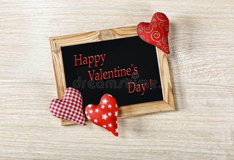 valentin för dag s En orientering för en vykort Träramen är tomma och hemlagade hjärtor lycklig s valentin för dag arkivfoto