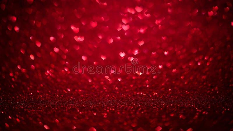 Valentindagbakgrund med röda bokehhjärtor Det röda förälskelsedagbegreppet blänker textur arkivfoto