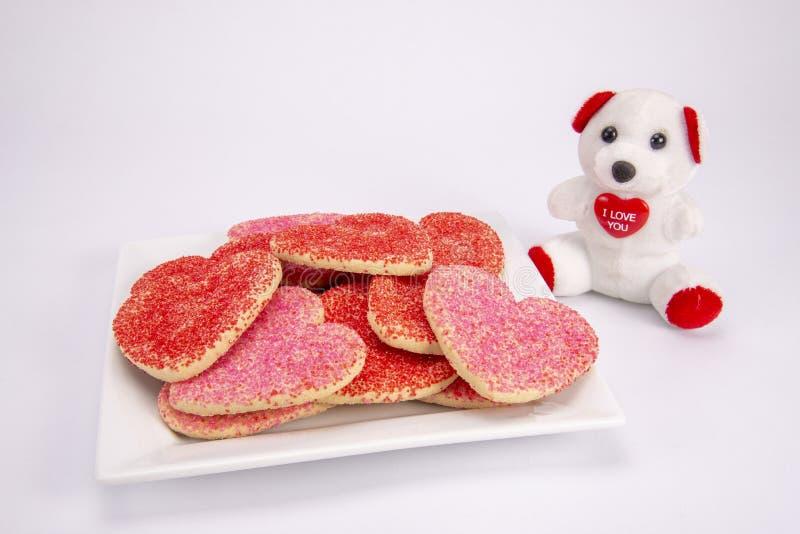 Valentindaggodis och kakor arkivbilder