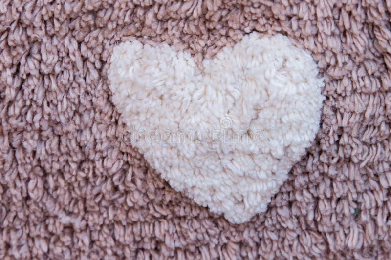 Valentindaghjärta på tyg royaltyfria foton