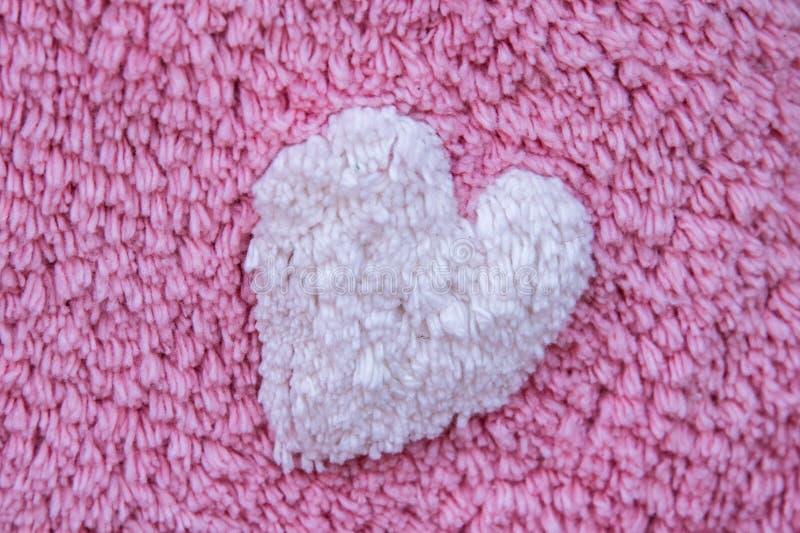 Valentindaghjärta på tyg arkivfoton