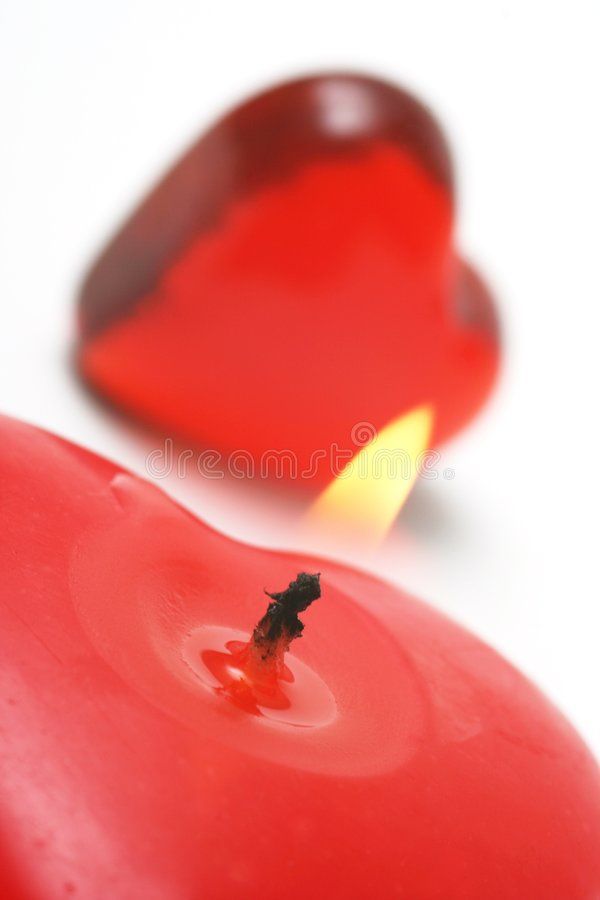 Valentine. Candle and Heart on white background stock image