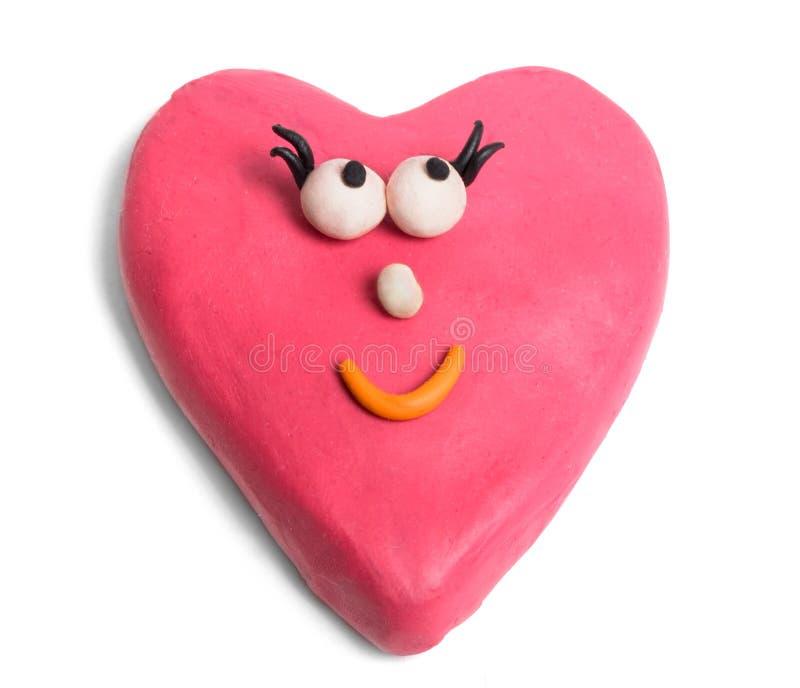Valentine. Female valentine made of plasticine isolated on white stock photo