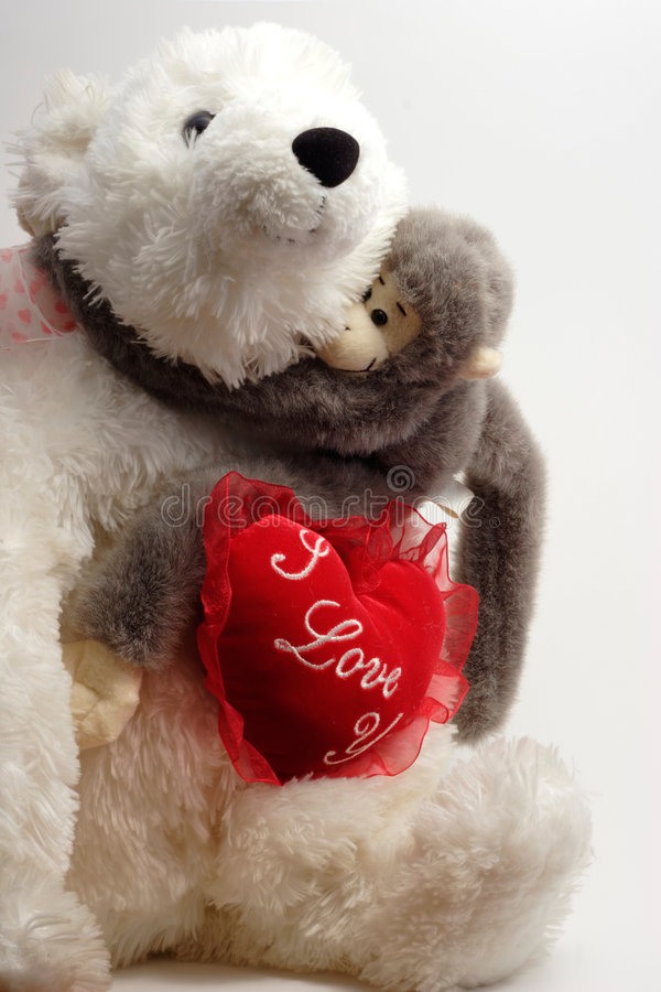 Valentine Bear Hug. Valentine Bear - Monkey Hug stock photo