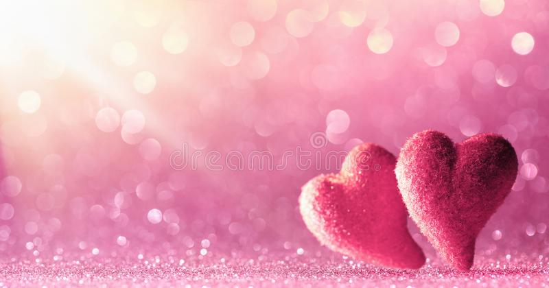 Two Hearts On Shiny Background royalty free stock photos