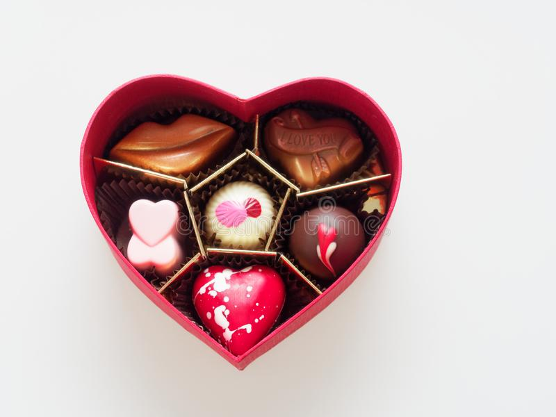 Valentine chocolate gift box in heart shape isolated over white background. Use in Valentine`s day or love related issue stock photography