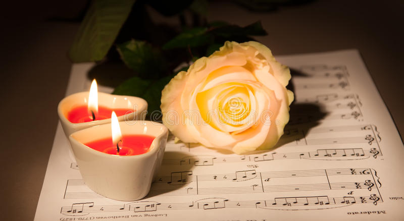 Valentine concept. Rose and two Heart Candles stock photos