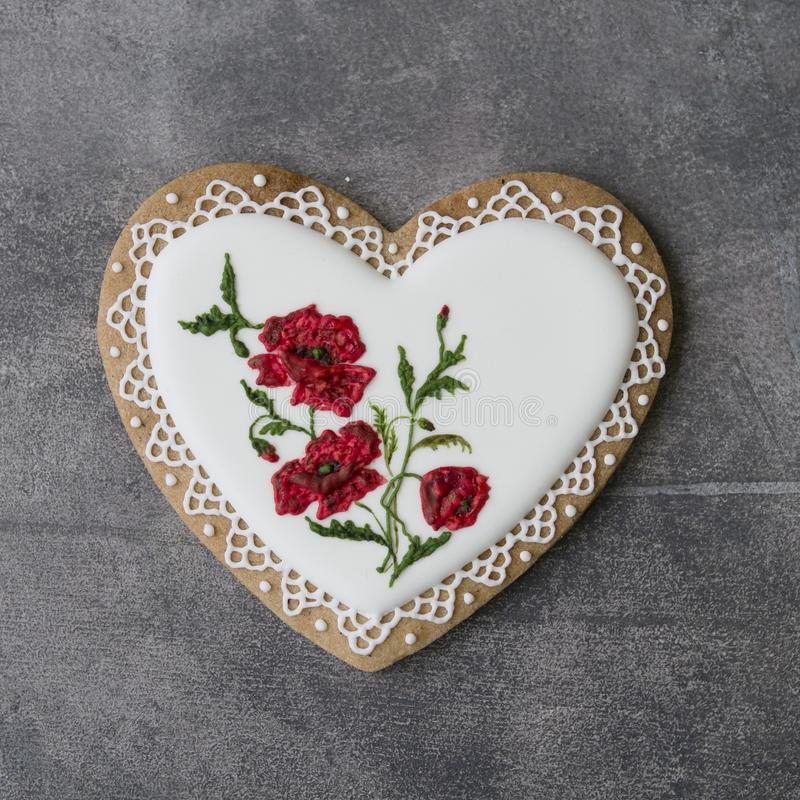 Valentine cookie heart decorated with red poppies in vintage style on gray background for Valentine`s Day, Mother`s Day, Women` stock photos